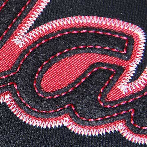 Applique with company name, tail and name drop