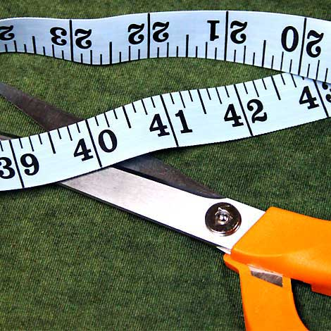 scissors, measure tape on a t-shirt